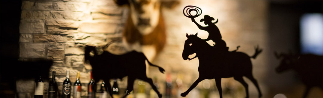 LongHorn Steakhouse branded image: cattle rancher silhouette